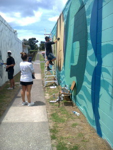 Lovey Smith of Street Prints supervises street art Mt Maunganui