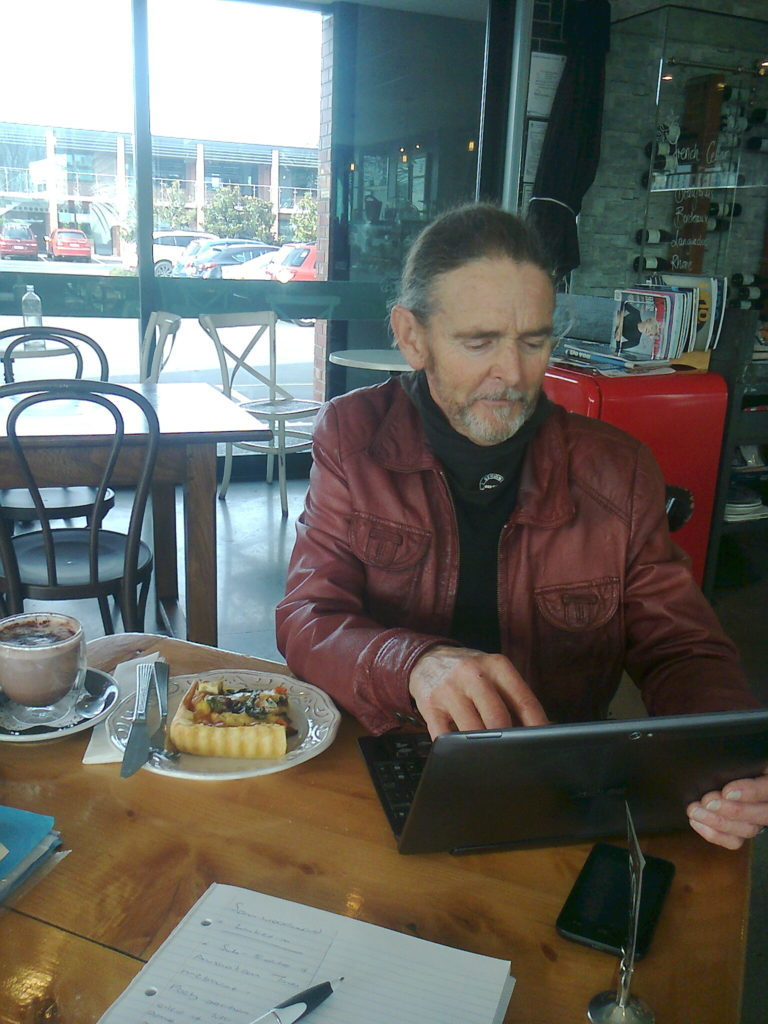 At QVis Cafe Sam checks the Australia Times publication of his poetry