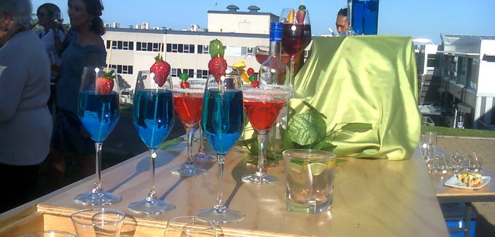 Vibrant coloured cocktails complete the summer evening